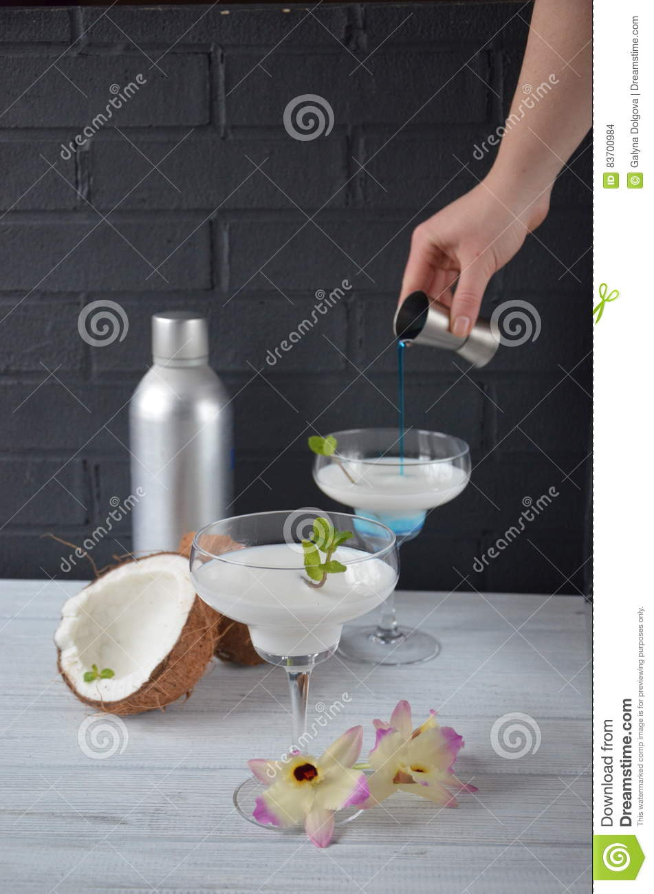 Pina Colada Drink In Cocktail Glass Decorated With Coconut And Orhid Flowers Stock Photo