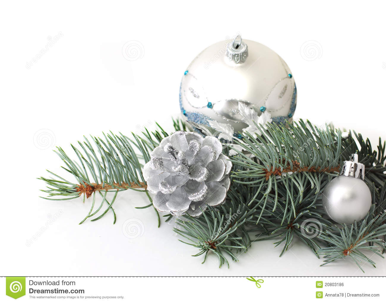 Pine branch and christmas silver decorations stock photo