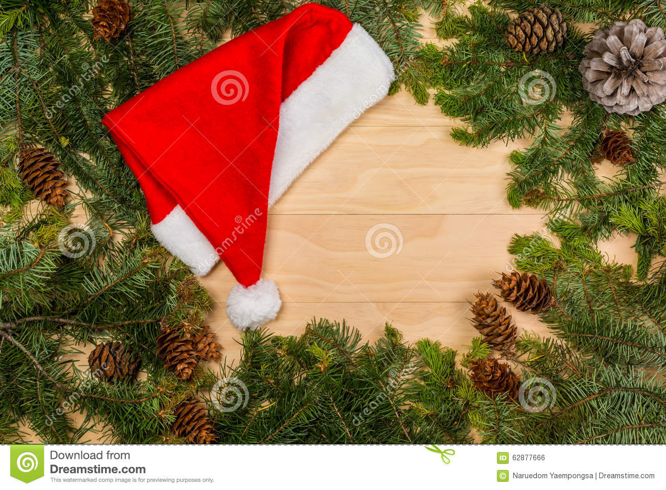 Pine cones and branches with Santa Claus red hat