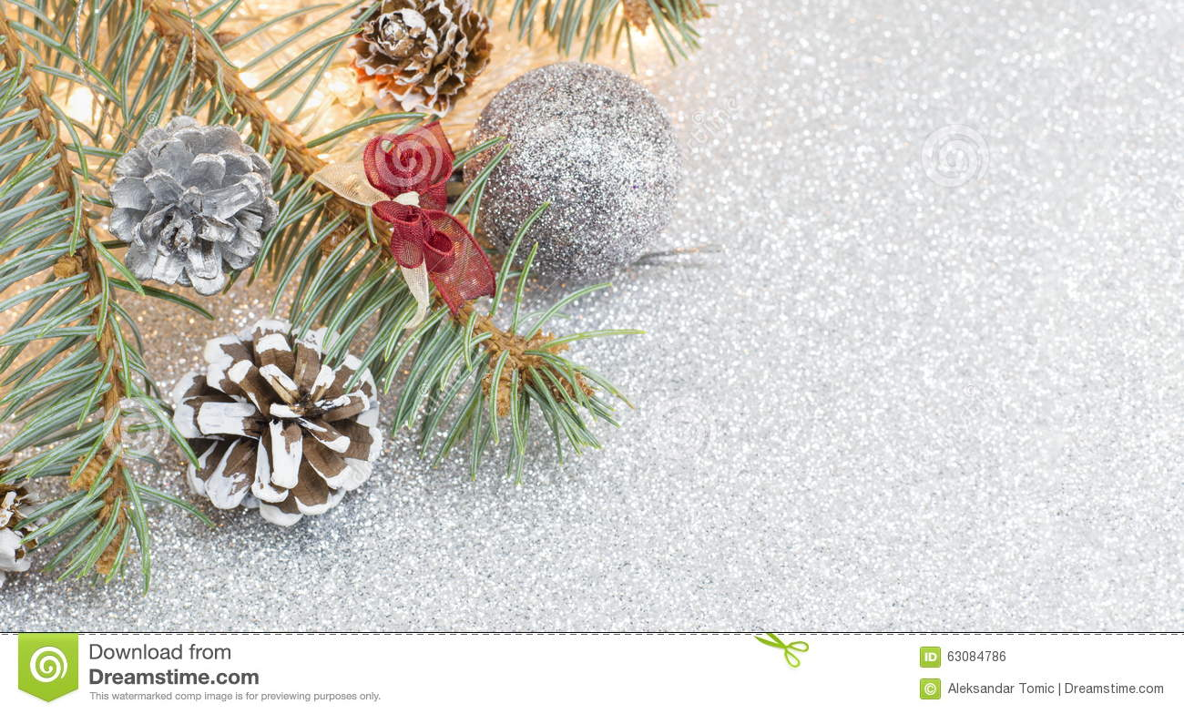 Pine cones and Christmas decorations on sparkling background