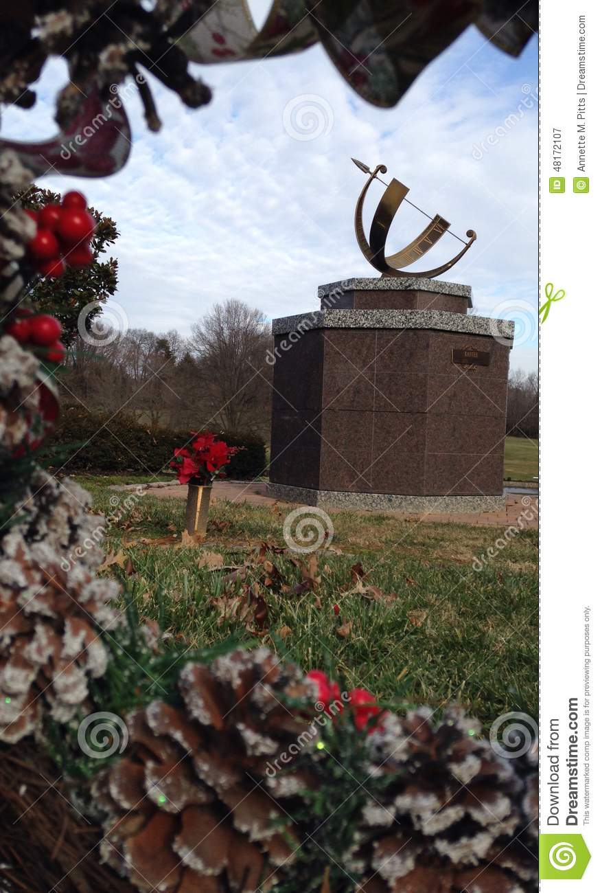 Pine Cones And Holly Framing A Sculpture Stock Image - Image of ...