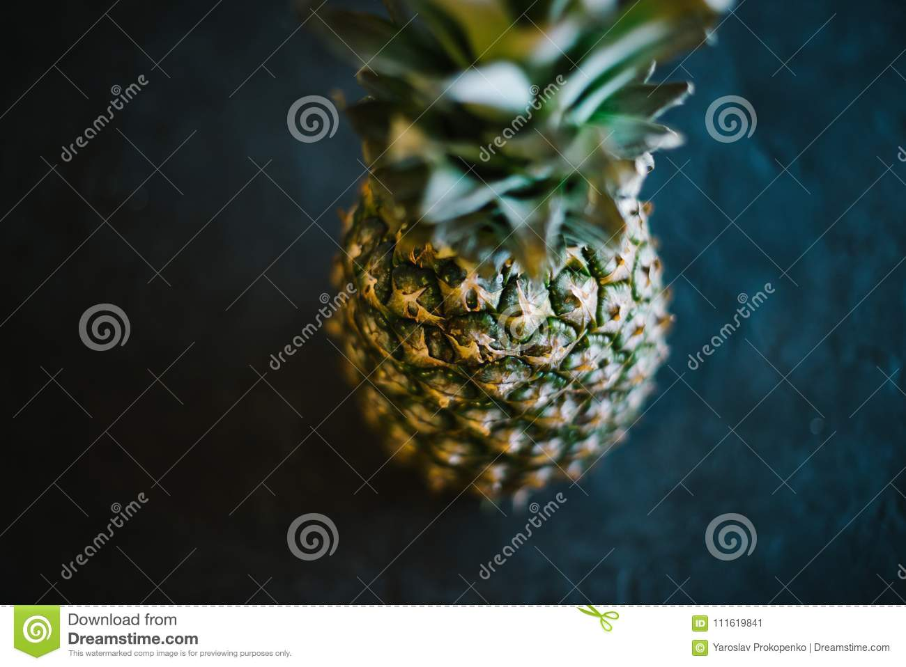 Pineapple on a black matte cement background