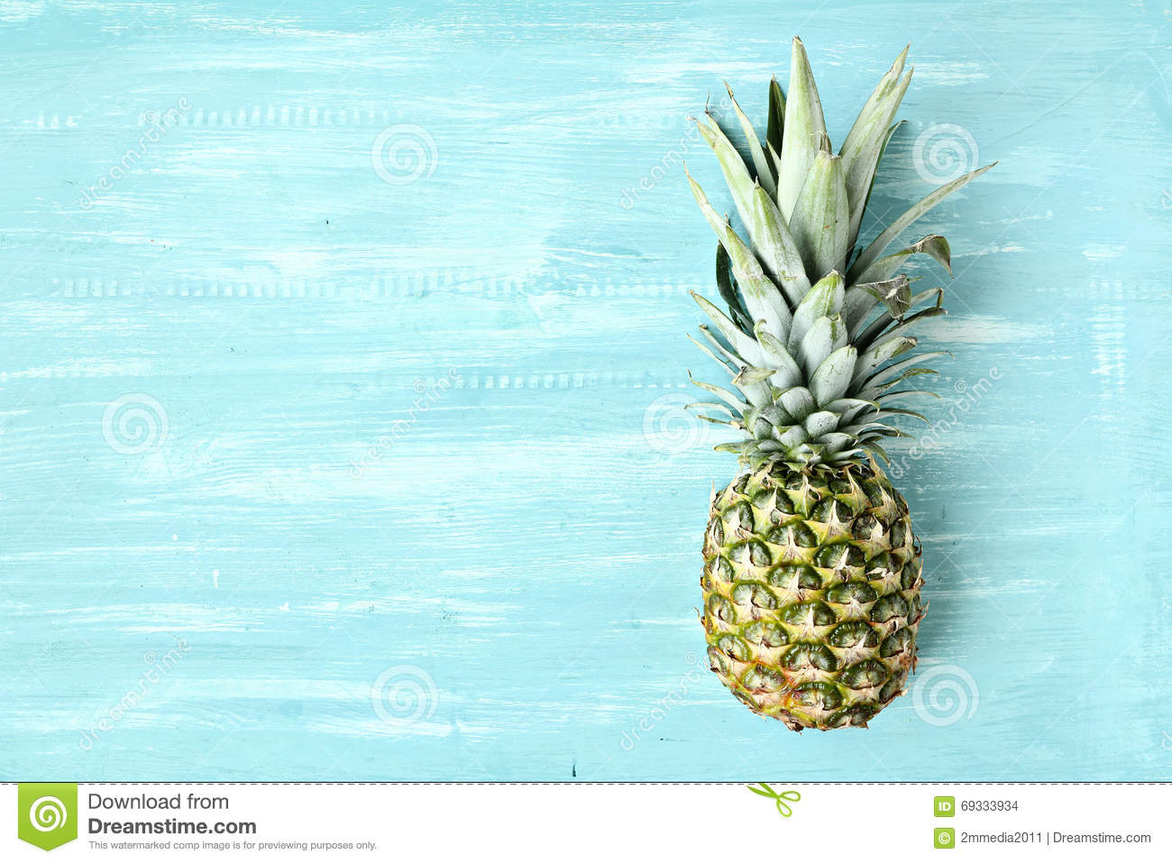Pineapple on a blue pastel background