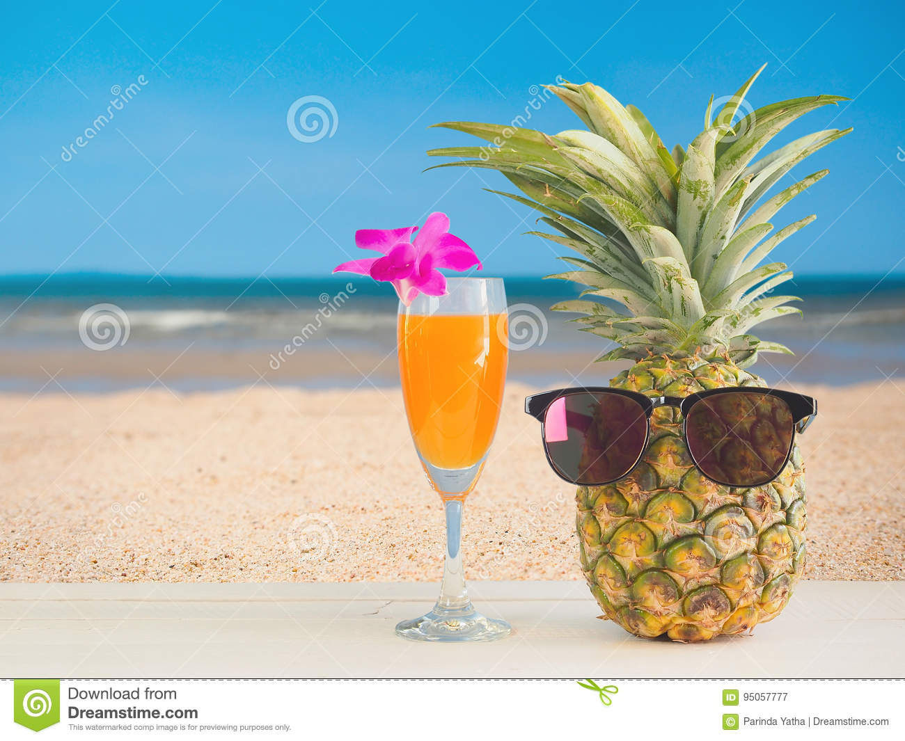 Pineapple At The Beach: Pineapple Juice With Sea Beach Background. Stock Image