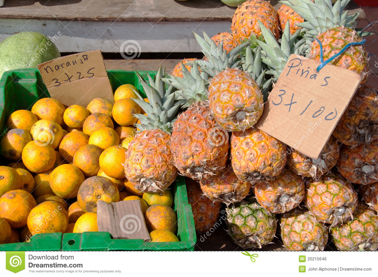 Pineapples and Oranges for Sale at Fruit Stand