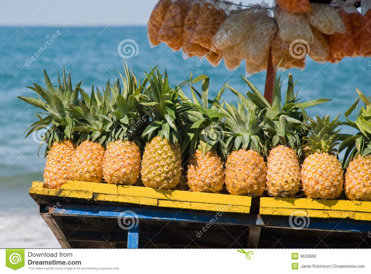 Pineapples for sale on tropical beach