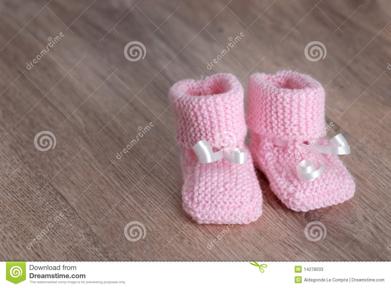 673dee81b92 Pink Baby Booties On Wooden Surface Stock Image - Image of ...