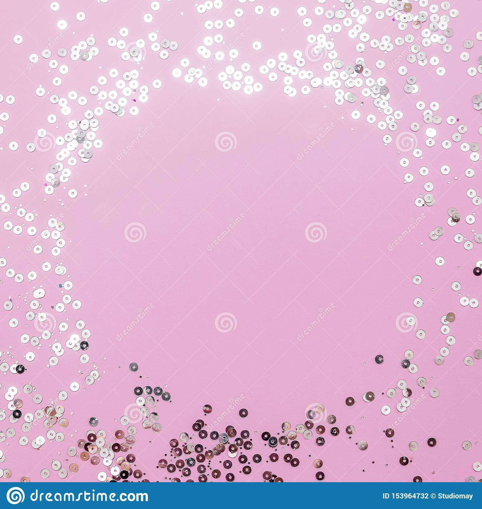 Pink background with holographic sparkles or sequins. Christmas, winter, birthday, celebration flat lay, square cropping. Social