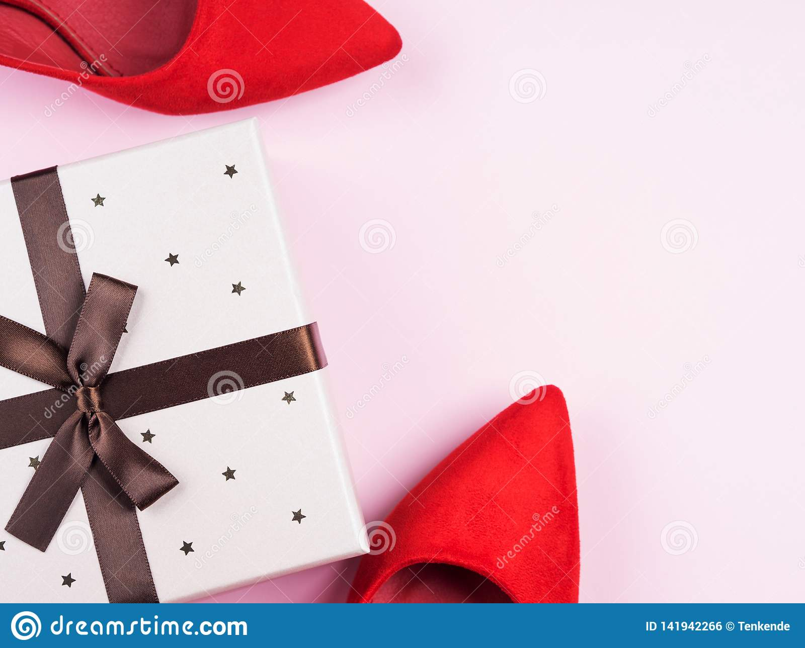 Pink Background With Red Shoes And Gift Box Stock Photo