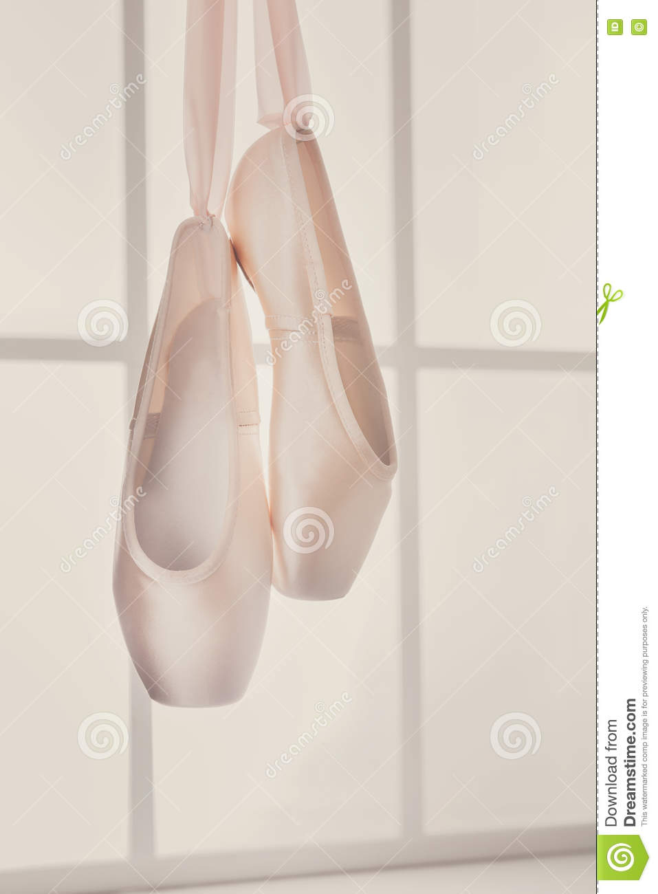 d28508dad273 Pastel pink ballet shoes background. New pointe shoes with satin ribbon  hanging on window, high-key soft toning, vertical image