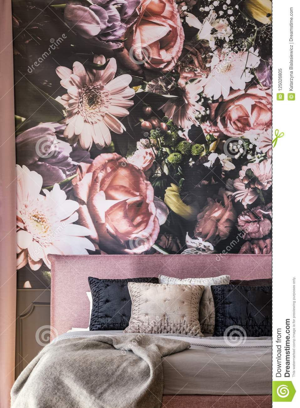 Pink And Black Pillows On Bed Against Flowers Wallpaper In Overw ...