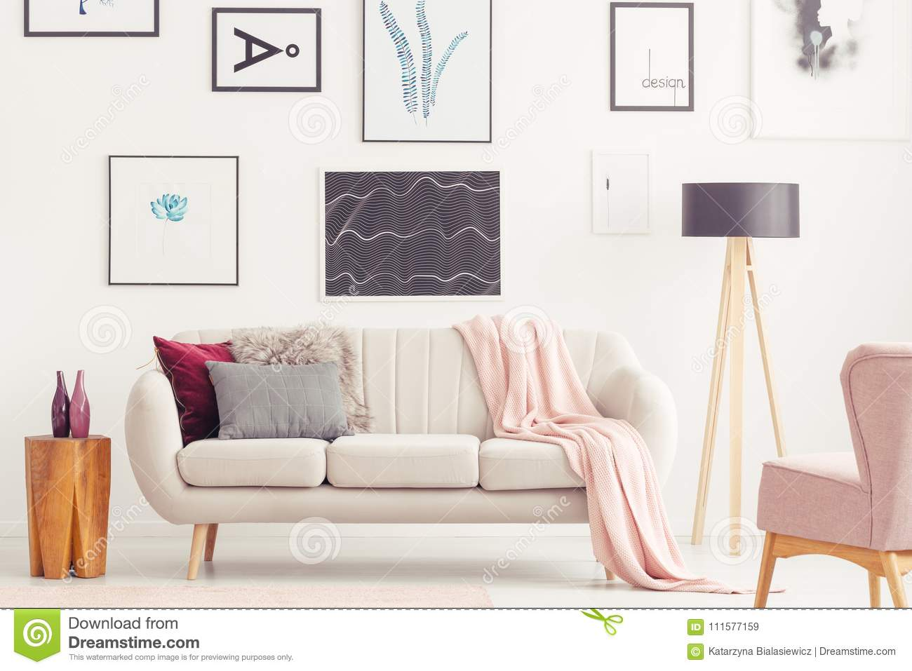 Pink Living Room With Posters Stock Image - Image of lamp, cushions ...