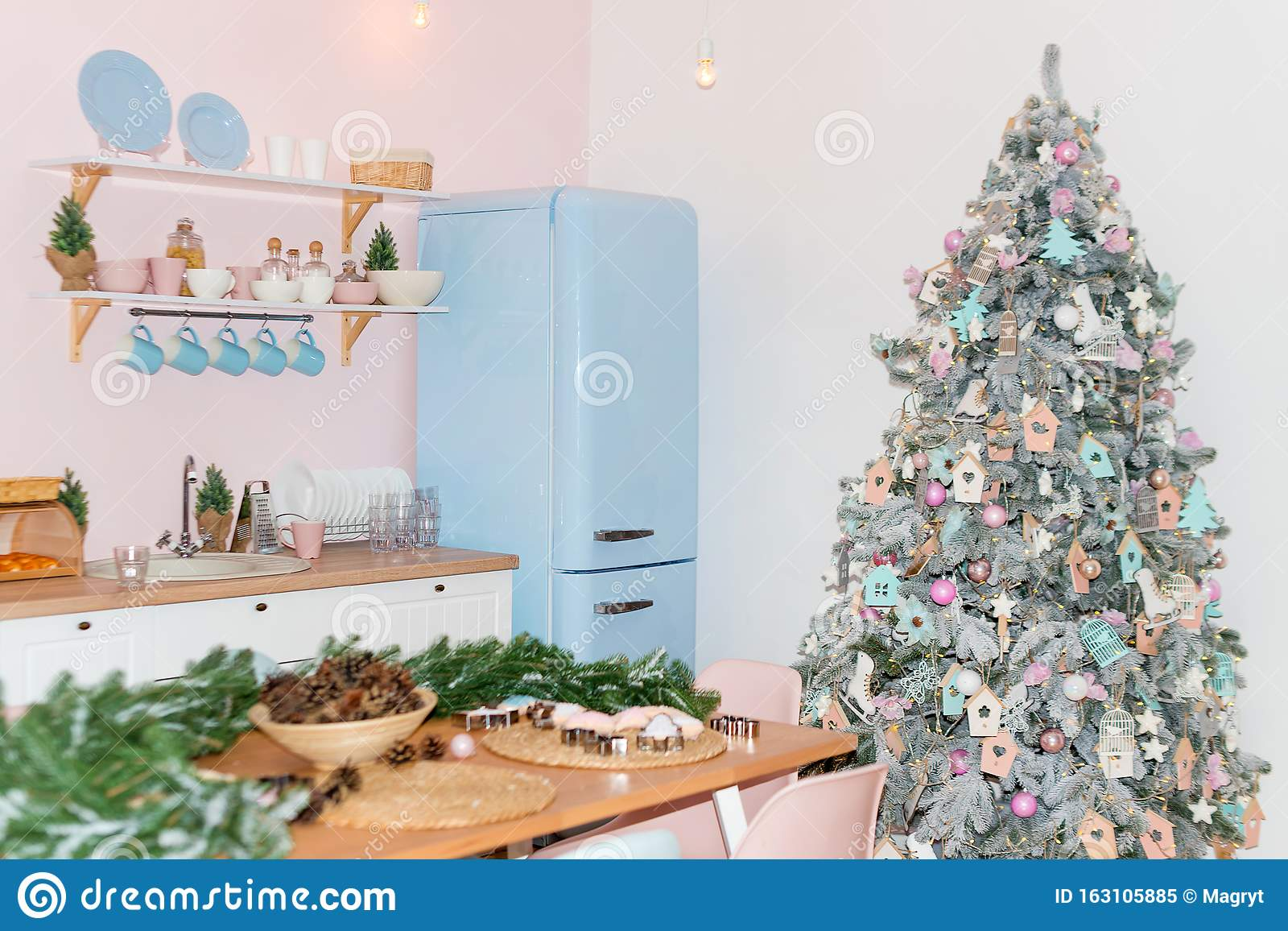 Pink And Blue Pastel Modern Kitchen Interior Decorated With Christmas Tree And Decorative Elements New Year Decorations Happy Stock Image Image Of Dining Floor 163105885
