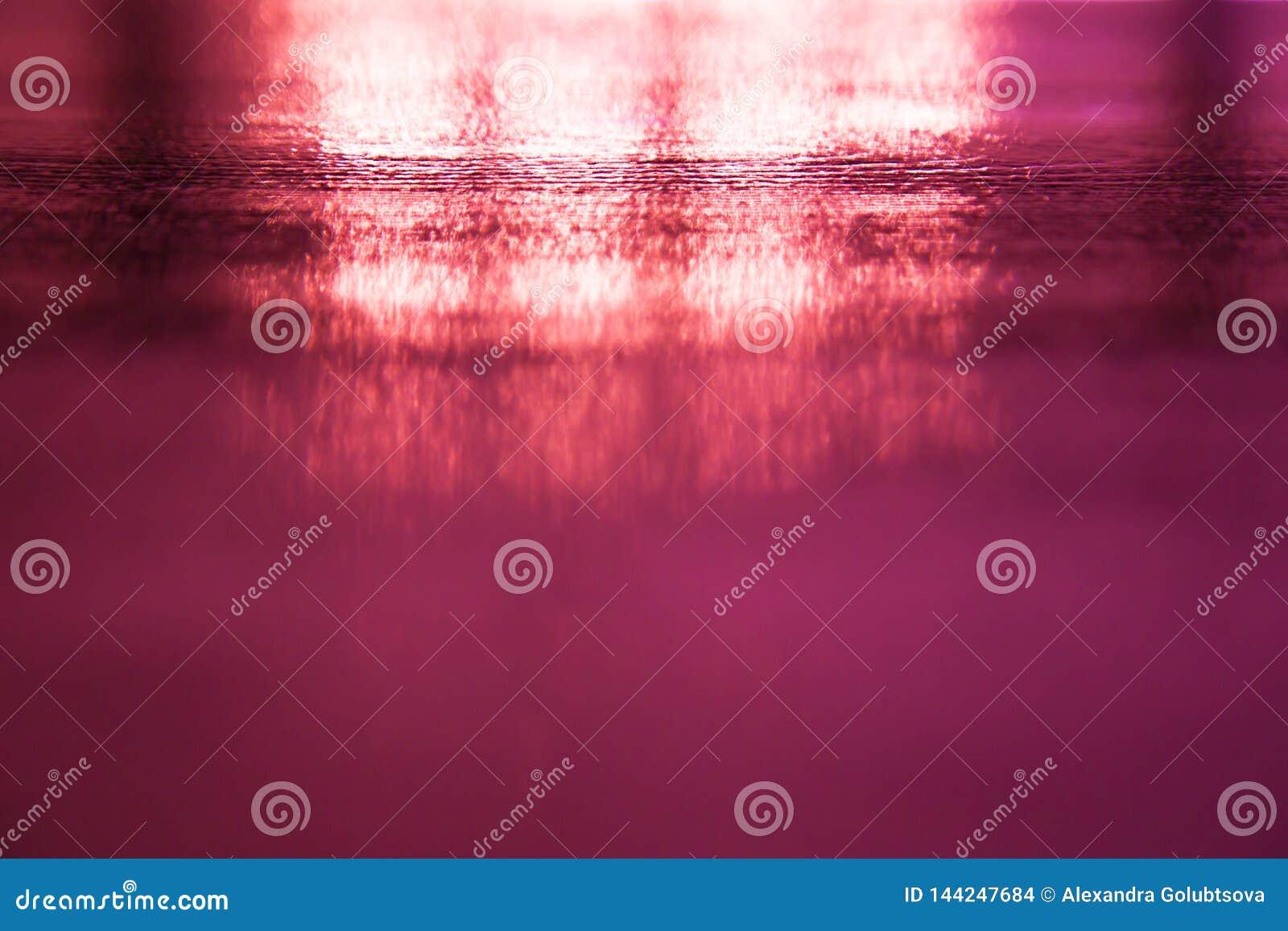 Pink blurred background.