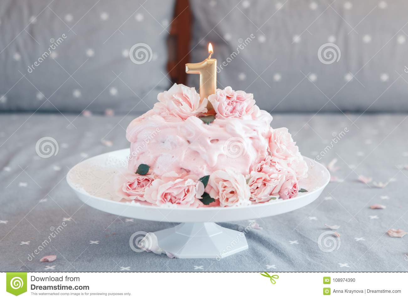 Pink cake with large natural real rose flowers and candle on stand gourmet pink cake with large natural real rose flowers and candle on stand in bedroom for baby birthday home indoors cake smash first year concept izmirmasajfo