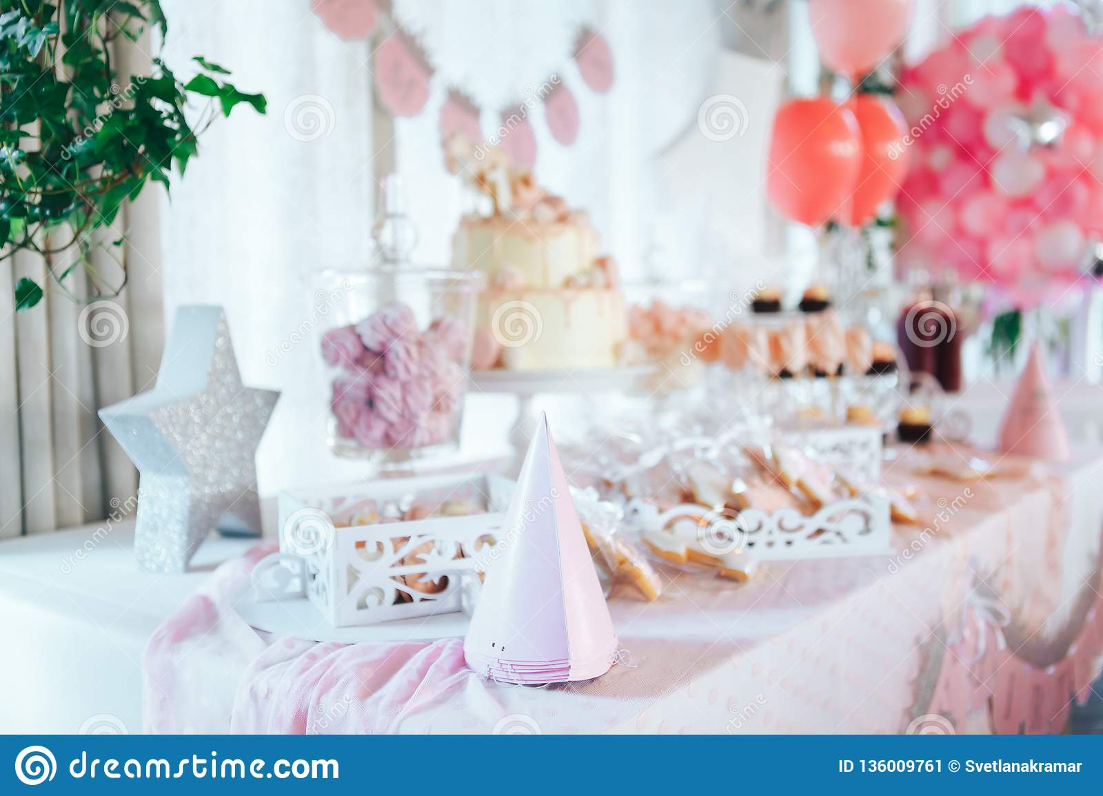 Pink candy bar for first birthday. Sweet table and big cake for first birthday