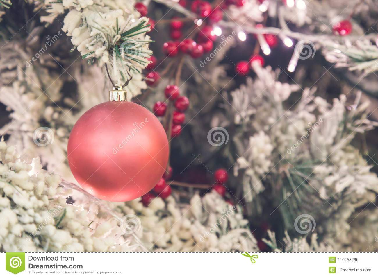 close up of pink christmas tree decorations