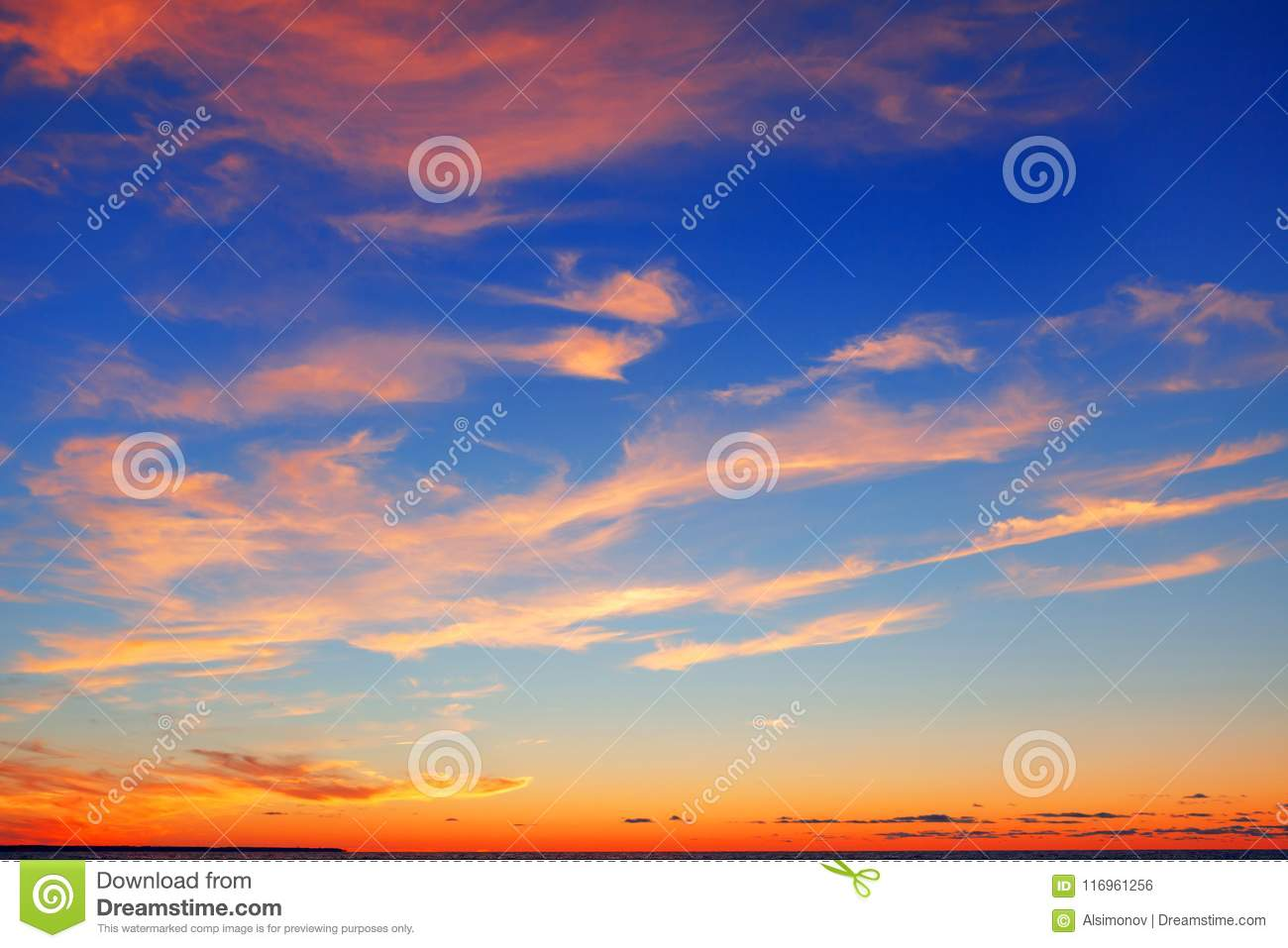 Pink clouds on a blue sky background after sunset