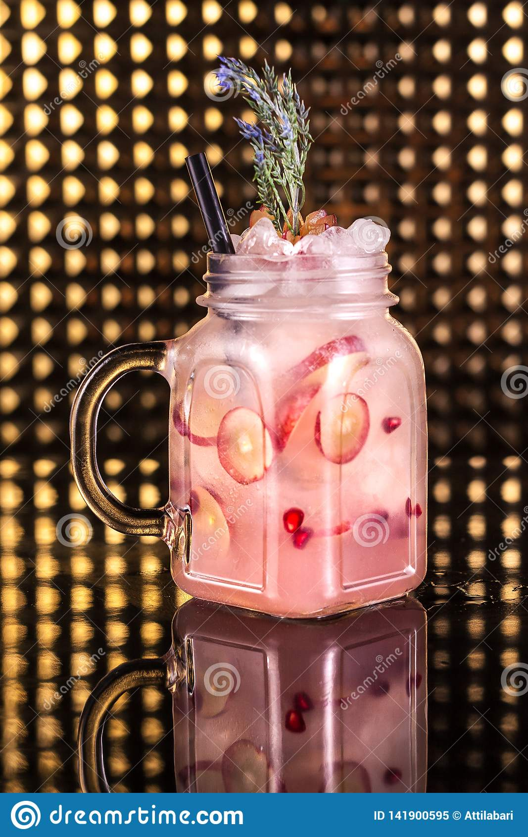 Pink cocktail lemonade with fresh passion fruit in vintage jar