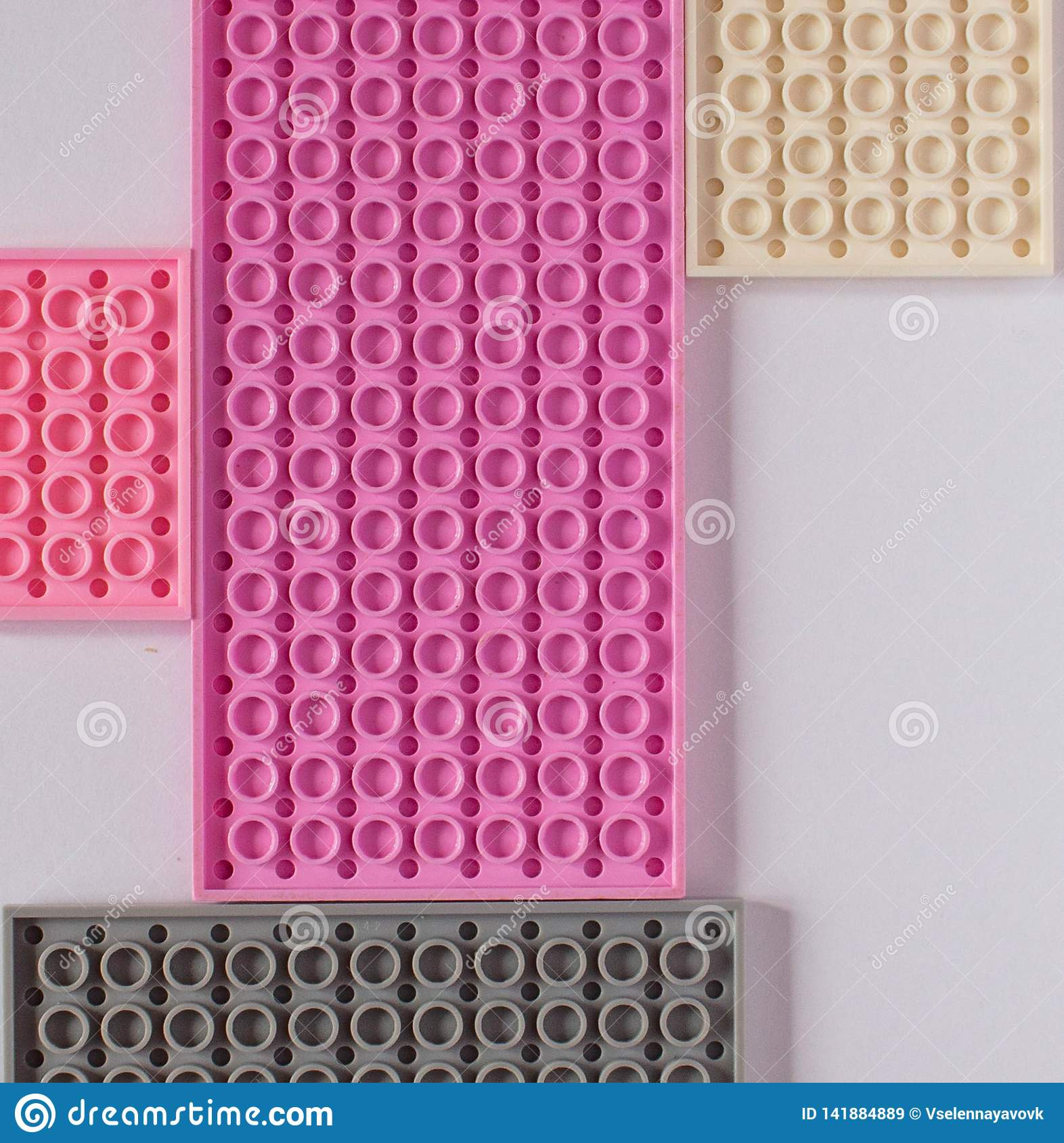 Pink constructor on a white background. Texture. Minimalism concept, Flat lay, top view, background