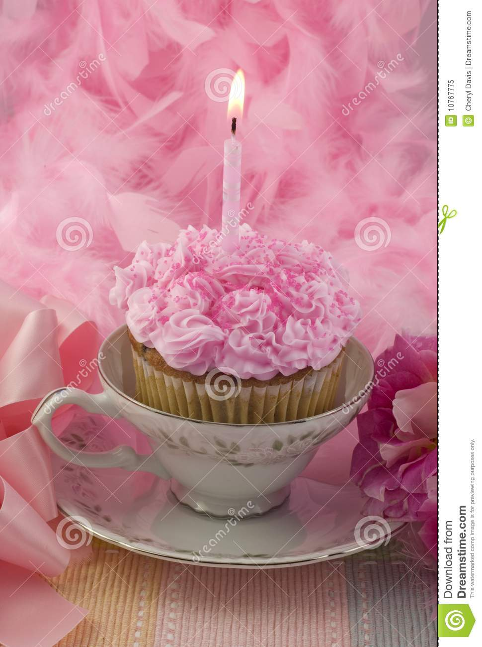 Pink Cupcake With Candle In Teacup Royalty Free Stock