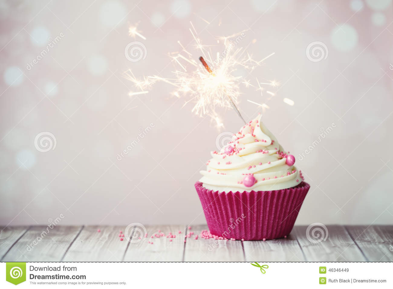 Pink Cupcake With Sparkler Stock Photo - Image: 46346449