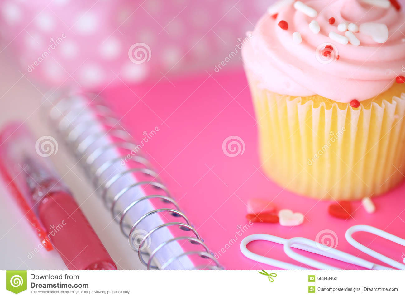 Download A Pink Cupcake With Sprinkles, A Pink Notebook, Paperclips And A Pen. Stock Photo - Image of concept, cupcake: 68348462