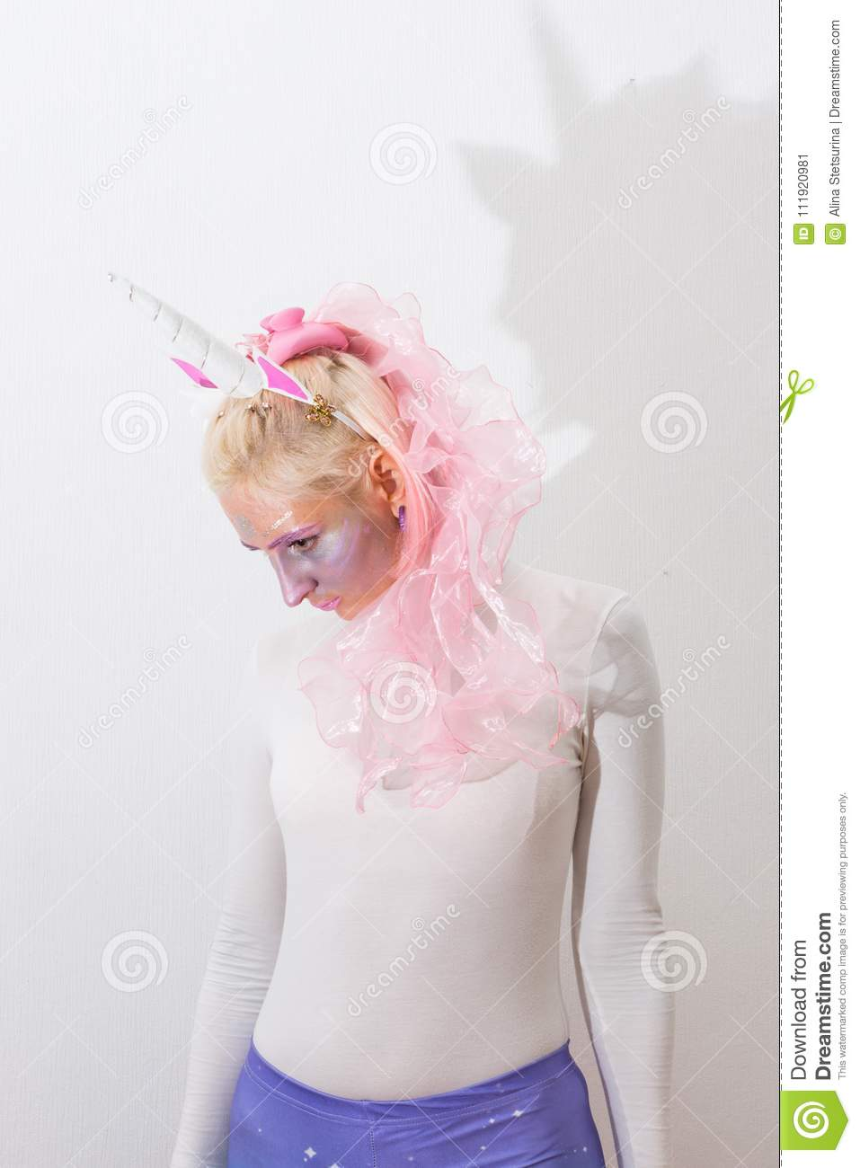 pink cute girl unicorn on white background young woman close up portrait halloween costume