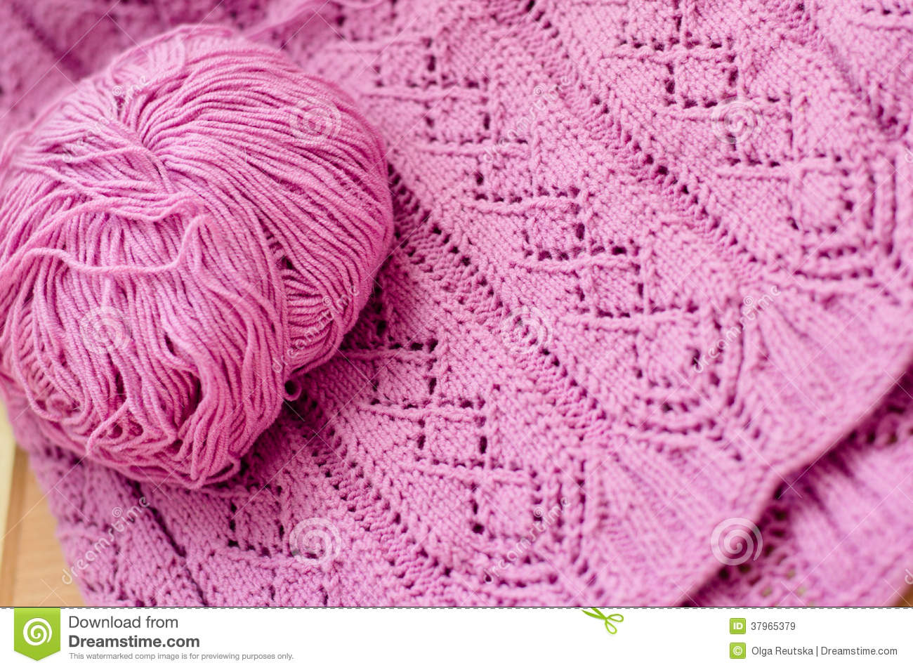 8e31f2ad9f1 closeup on pink detail of woven handicraft knit woolen design texture and  clew. Fabric pink background