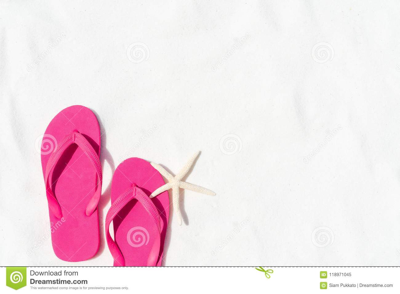 431ef51068e9 Pink flip flop put or step on on White sandy beach background with starfish  for summer holiday and vacation concept.
