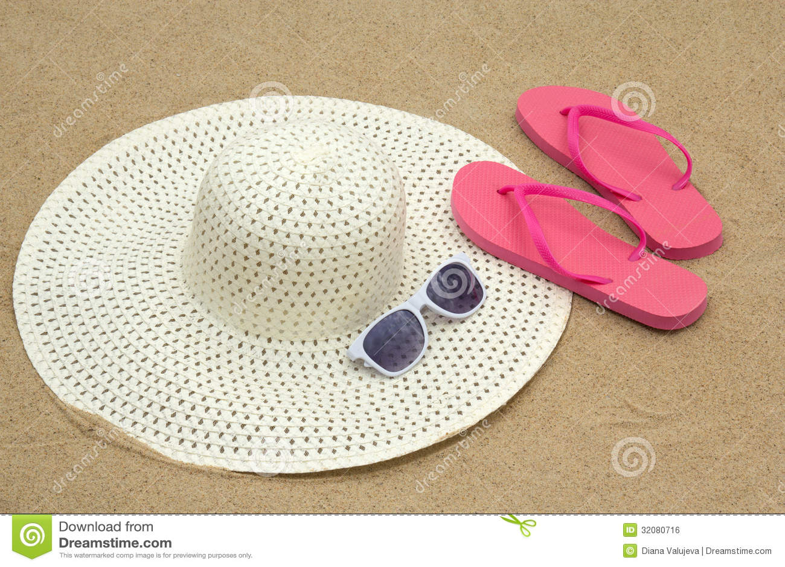pink flip flops sunglasses  hat  beach sand royalty