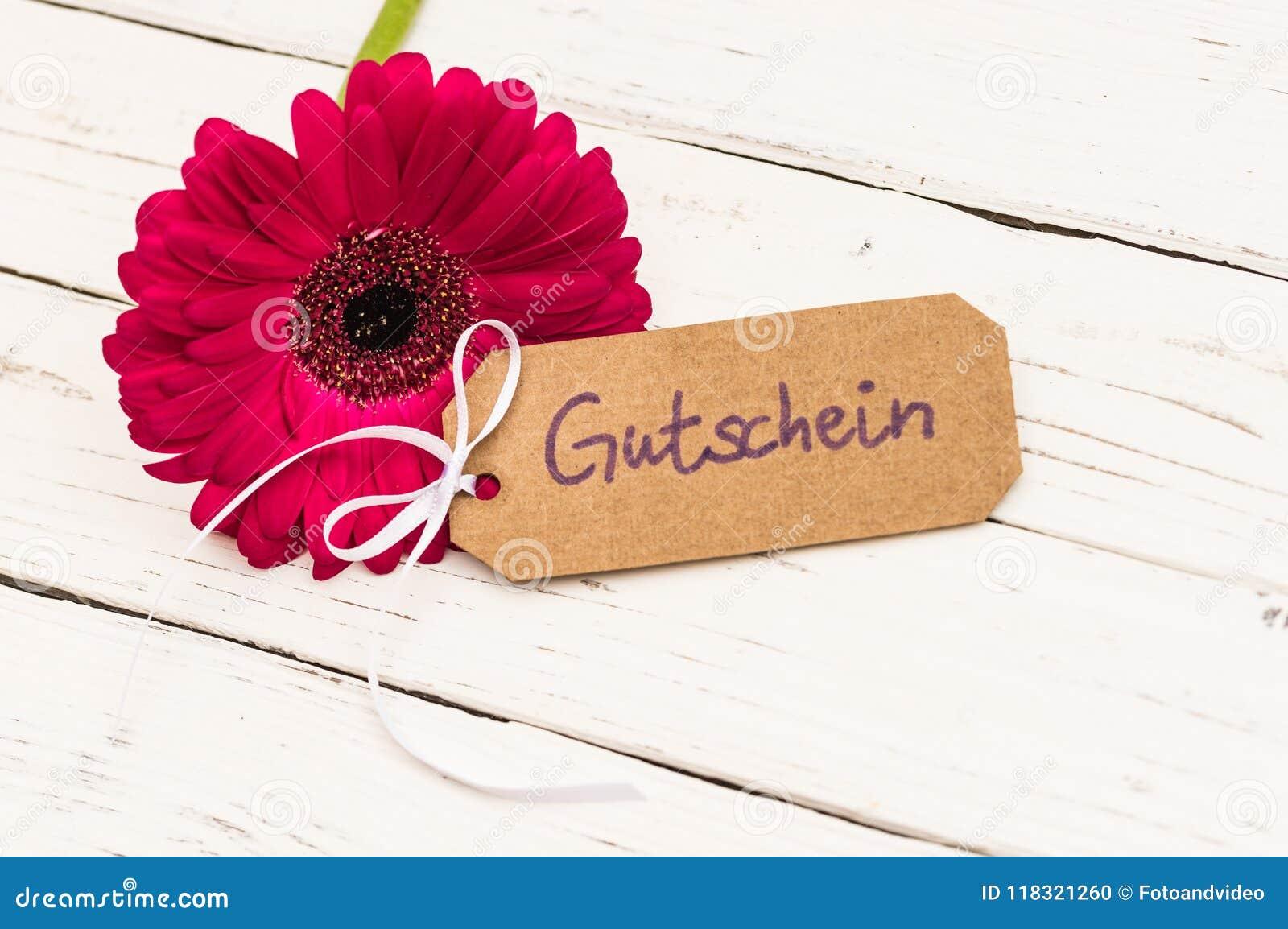 Gift Card With German Word Gutschein Means Voucher And Flower On