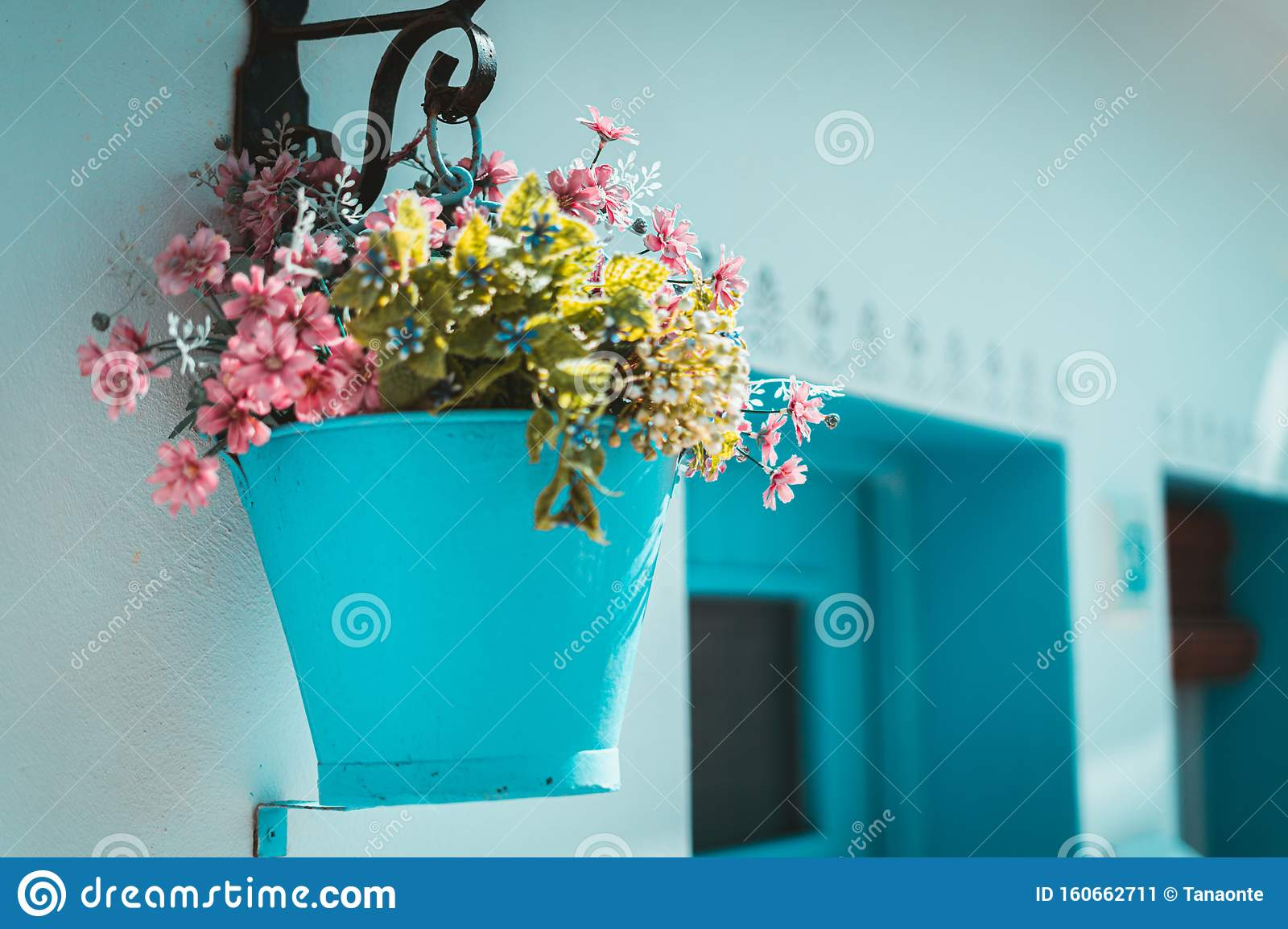 Pink Flowers In A Blue Bucket Hung On A White Wall Typical Mediterranean Village Stock Image Image Of Romantic Relax 160662711