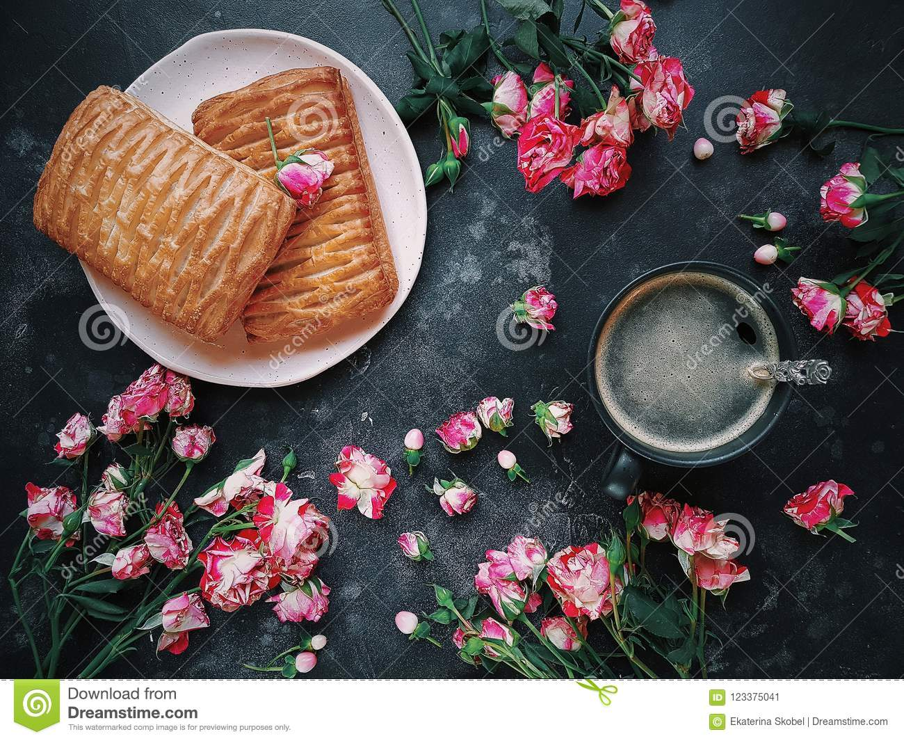 Pink Flowers Puff Pastries And Coffee On A Dark Background Bush