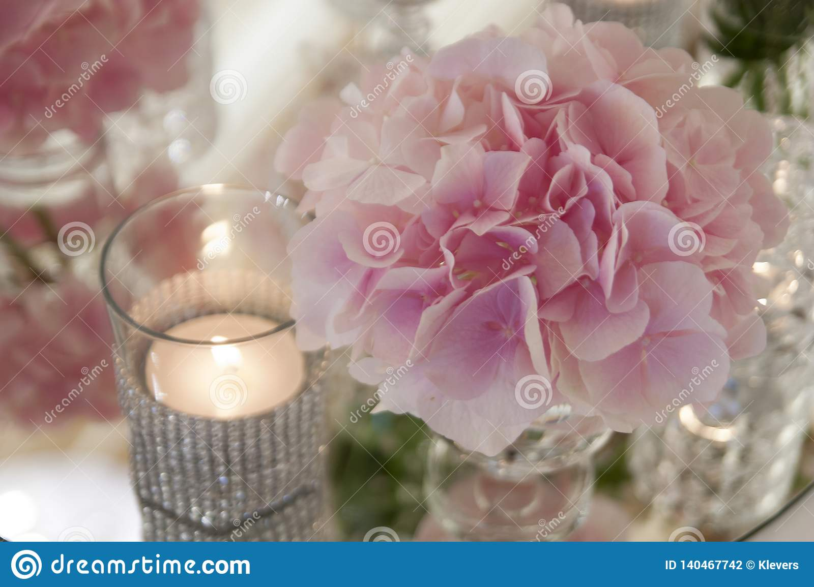 Dreamstime.com & Pink Flowers In Small Glass Vases Stand On The Mirror On The ...