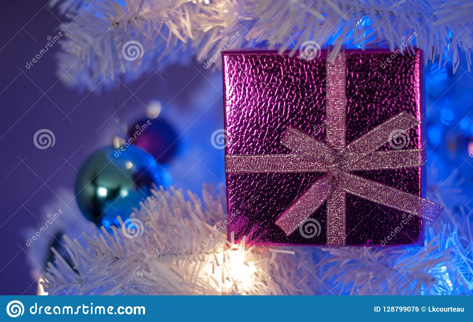 Pink Gift Box In White Christmas Tree With White Light Blue Light Teal Ornament Purple Ornament White Ornament Stock Photo Image Of Present Ornament 128799076