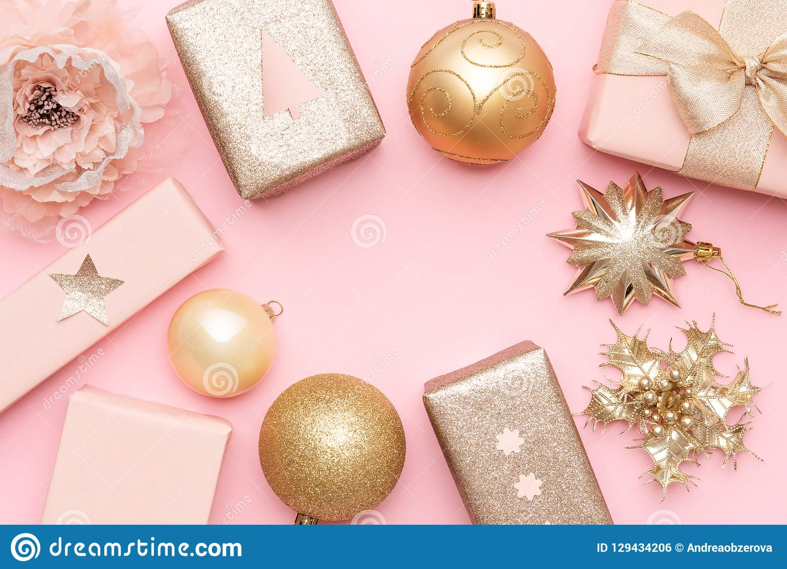 Pink And Gold Christmas Gifts Isolated On Pastel Pink Background