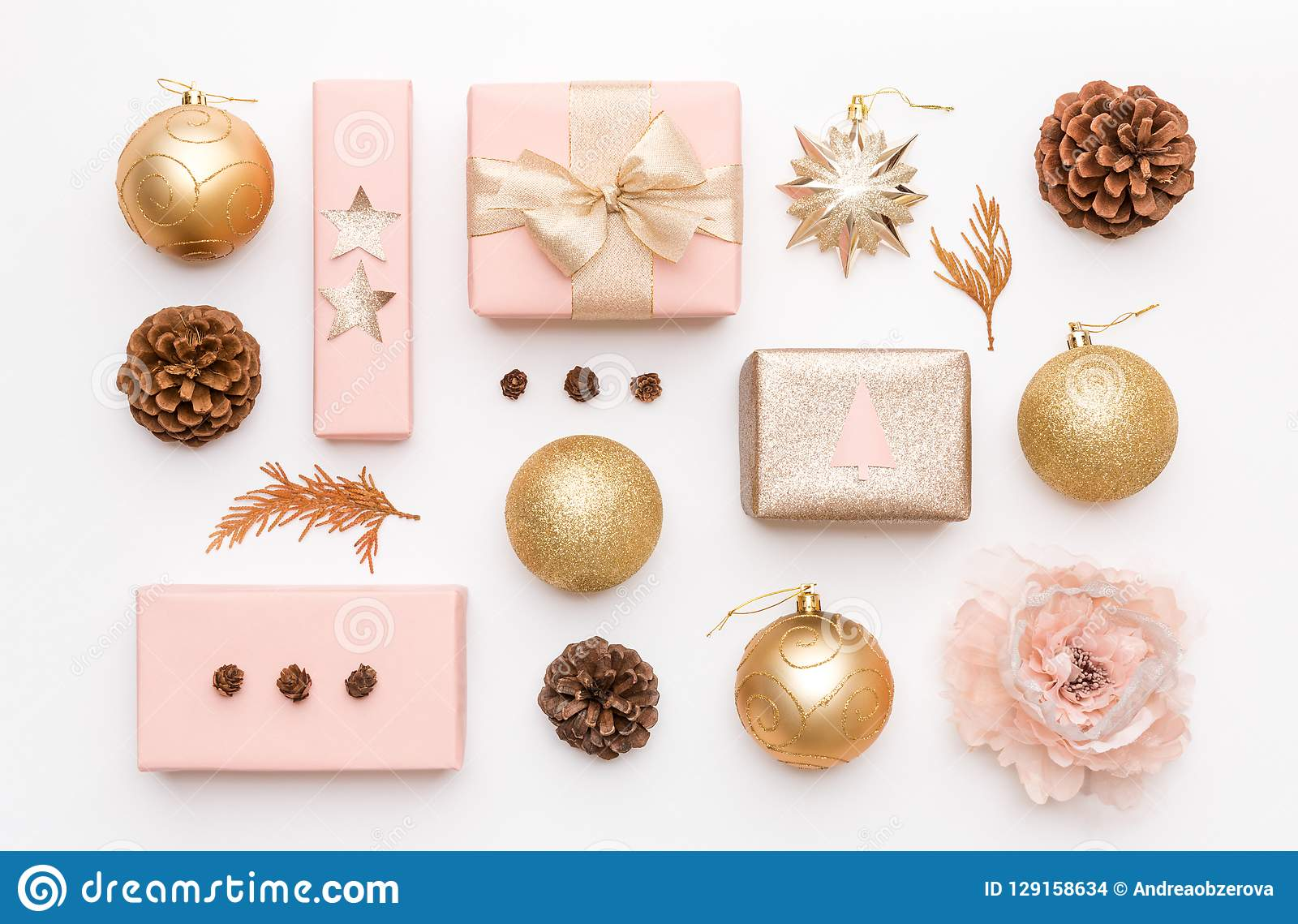 Pink And Gold Christmas Gifts Isolated On White Background Wrapped