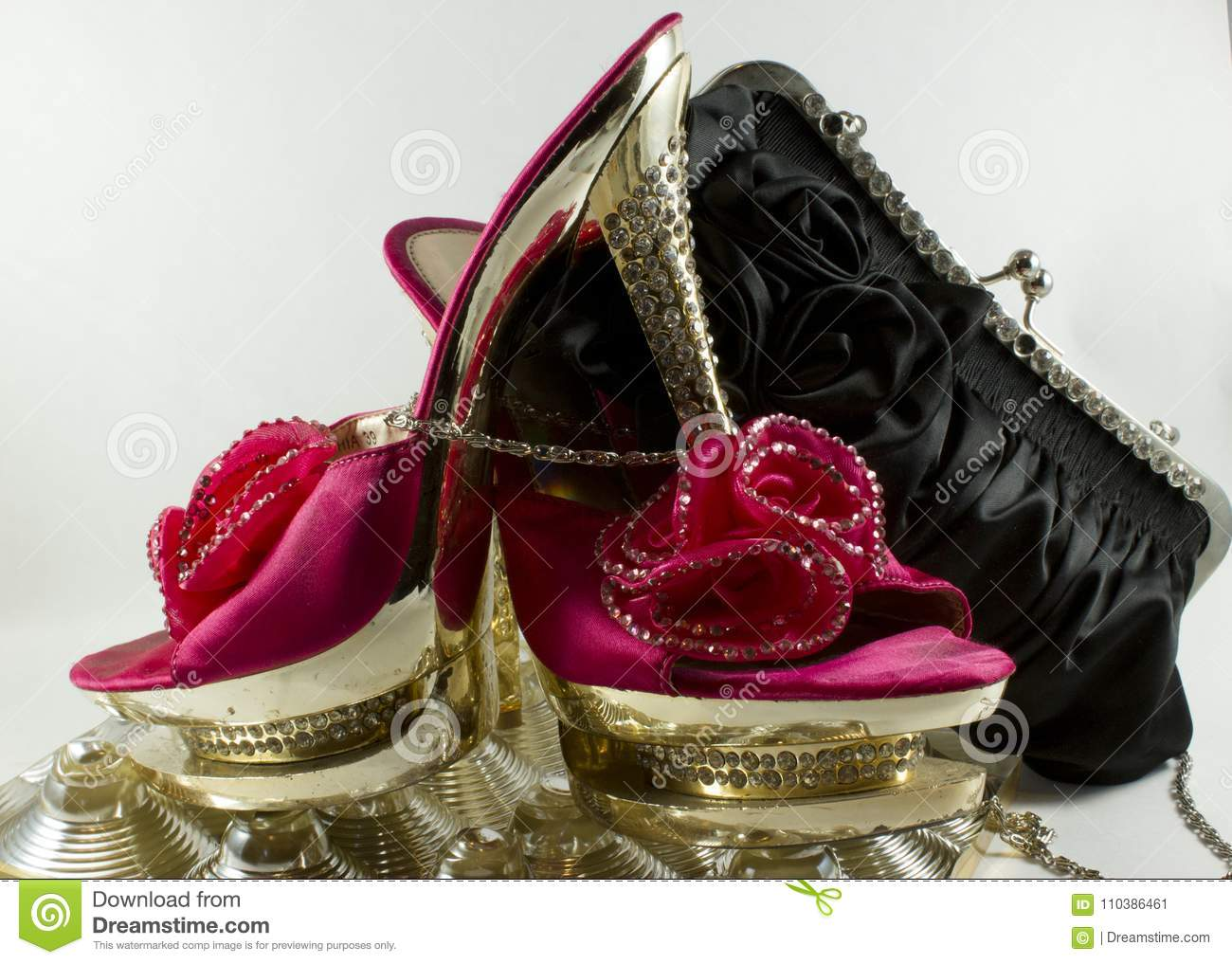 Pink and gold shoes with glitter and flower and black bag on wh beautiful and pink shoes with heels studded with glitter enriched with flower with a black handbag with flowers and glitter izmirmasajfo