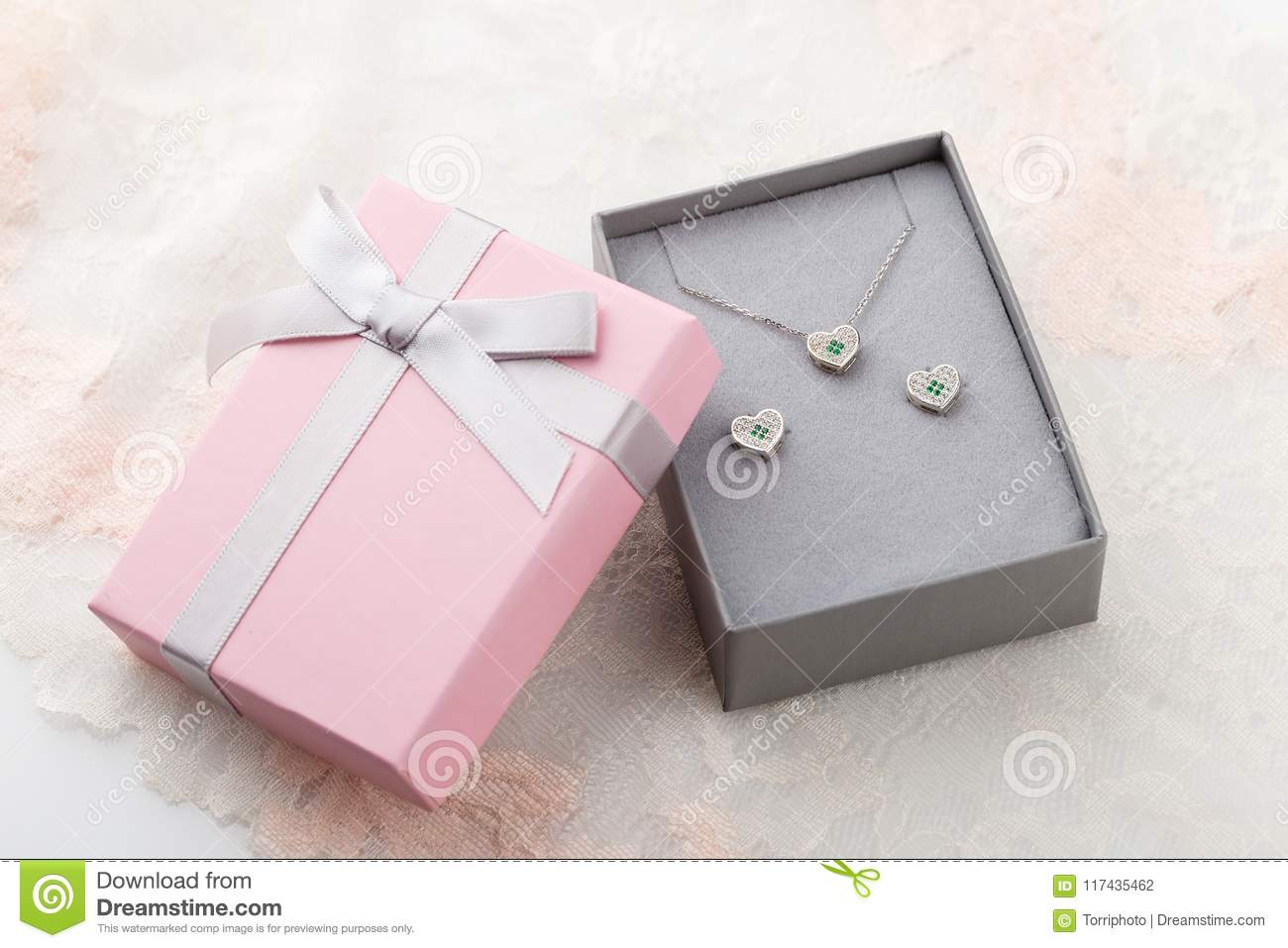 Pink And Gray Gift Box For Jewelry Set With Bow On Lace Background