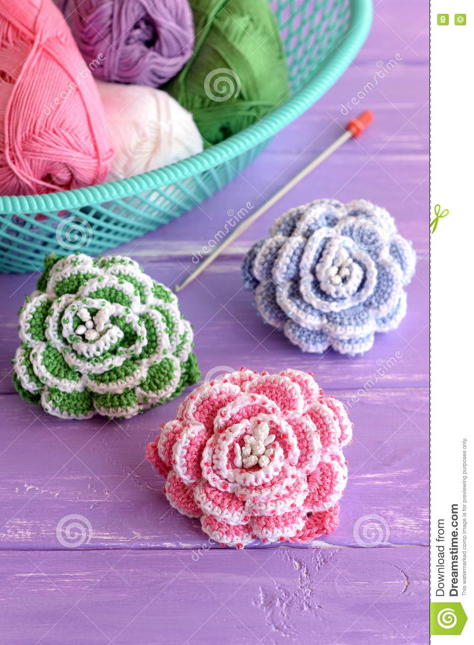 Pink green and blue crochet flowers decorated with beads cotton royalty free stock photo izmirmasajfo