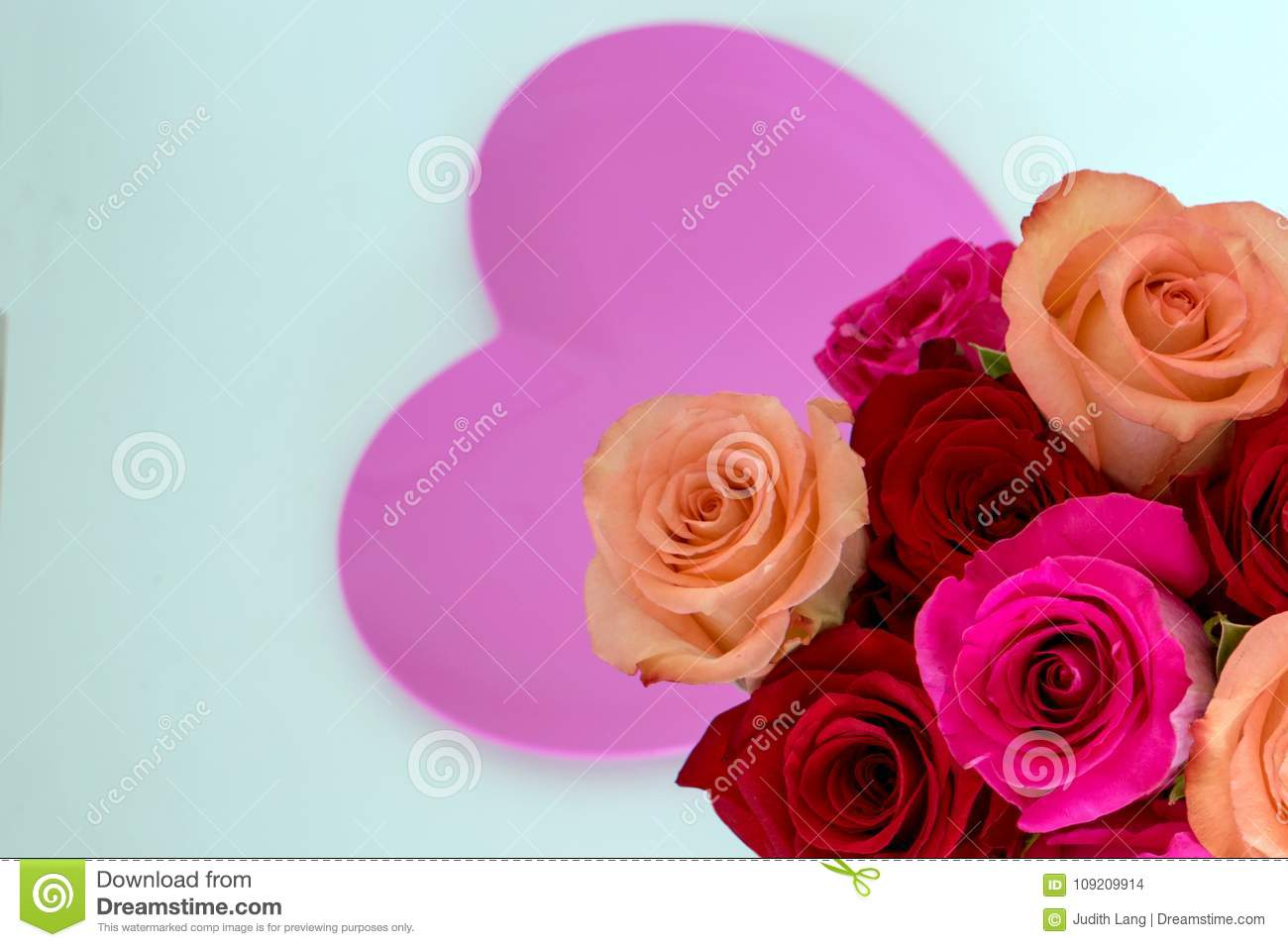 Pink heart in center with pink and red roses in right corner