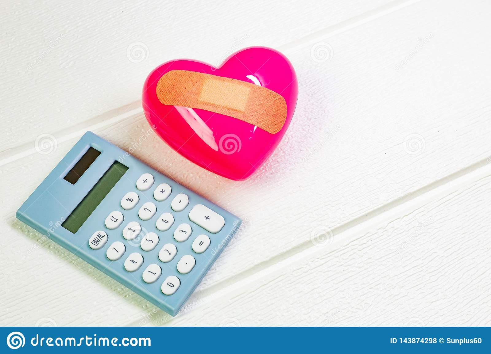 Pink Heart on white wood for medical content