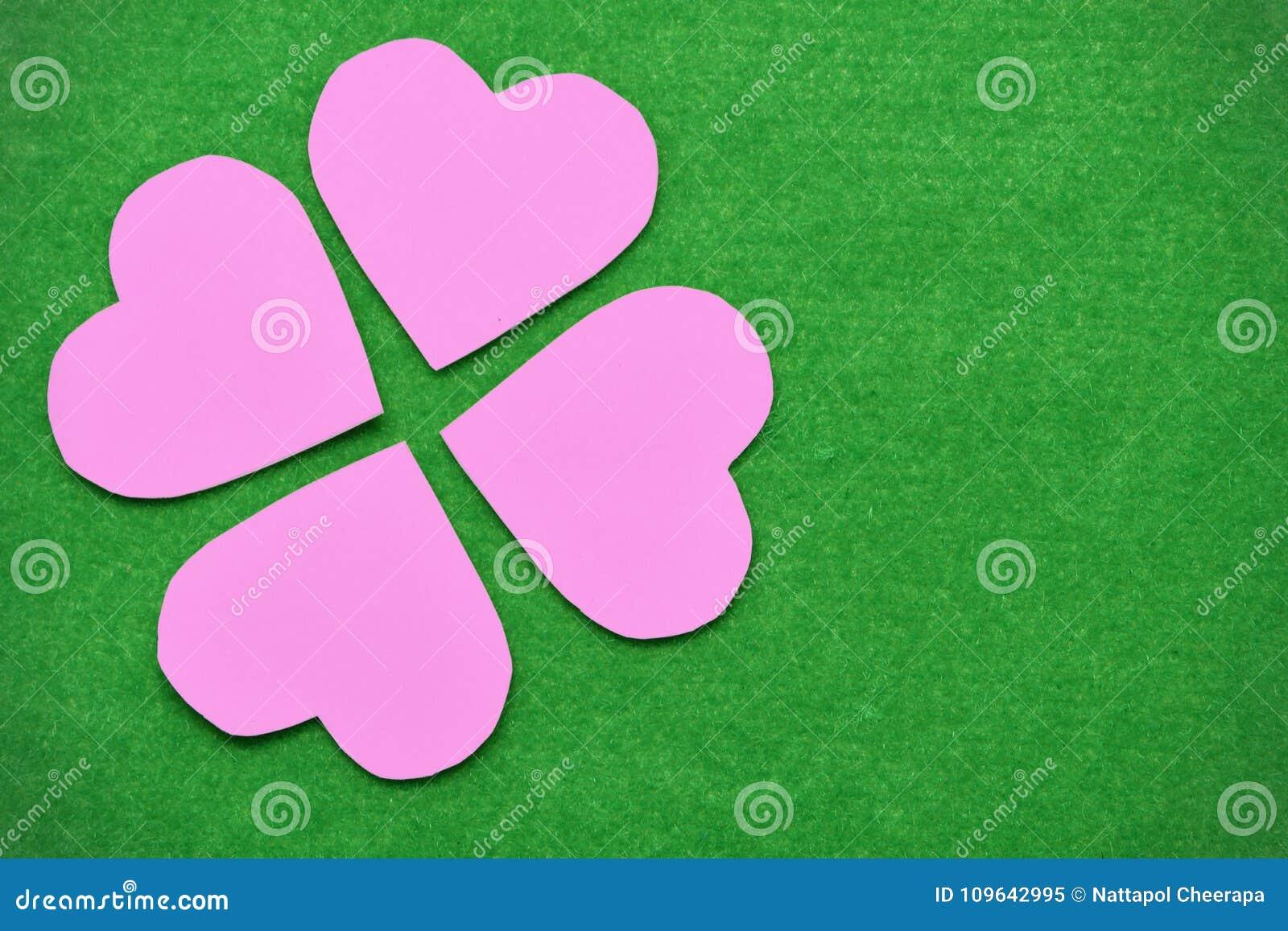 pink-hearts-arranged-like-flower-petals-placed-moist-green-spaces-109642995.jpg