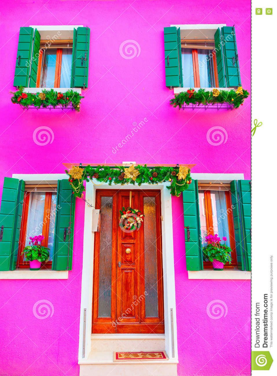 pink house with christmas decoration on the island burano, venic