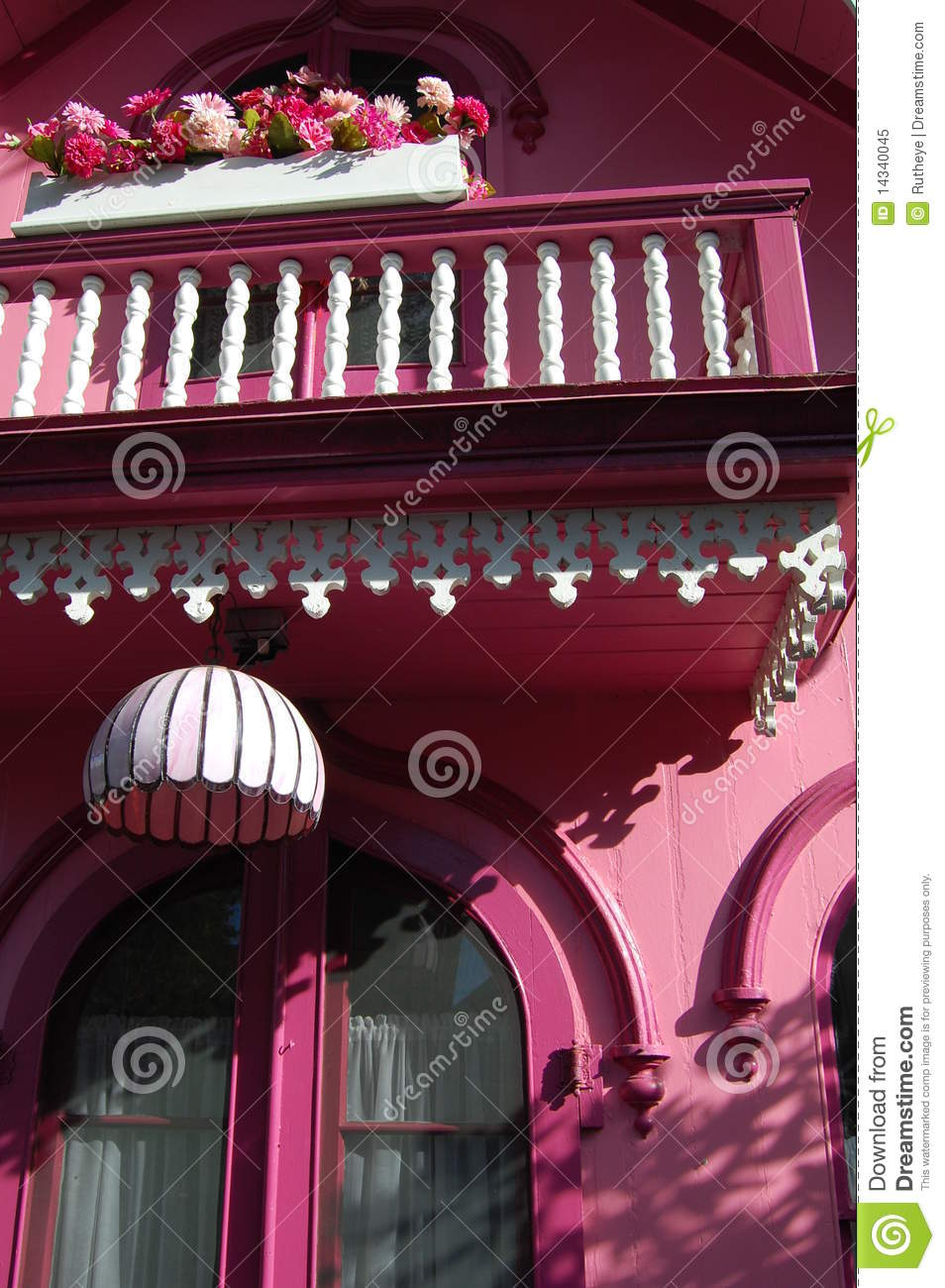 Pink house with railing