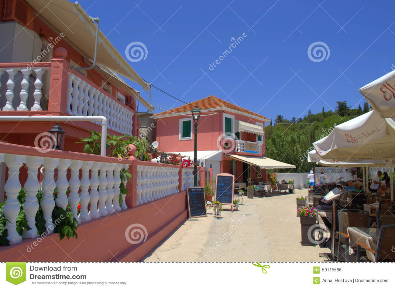 Pink Houses And Outdoor Restaurant Seating Editorial Photo Image Of Colorful Kefalonia 59115586