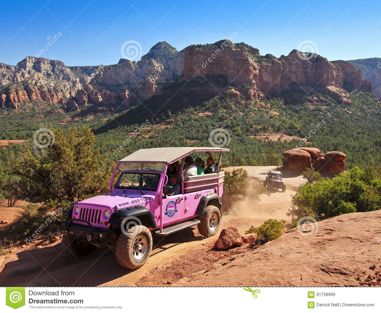 A Pink Jeep Tour Descends Broken Arrow Trail Editorial