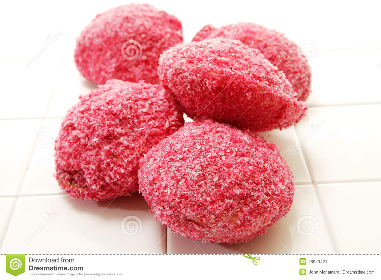 collection of round pink lamington snowballs frosted with cocnut on ...