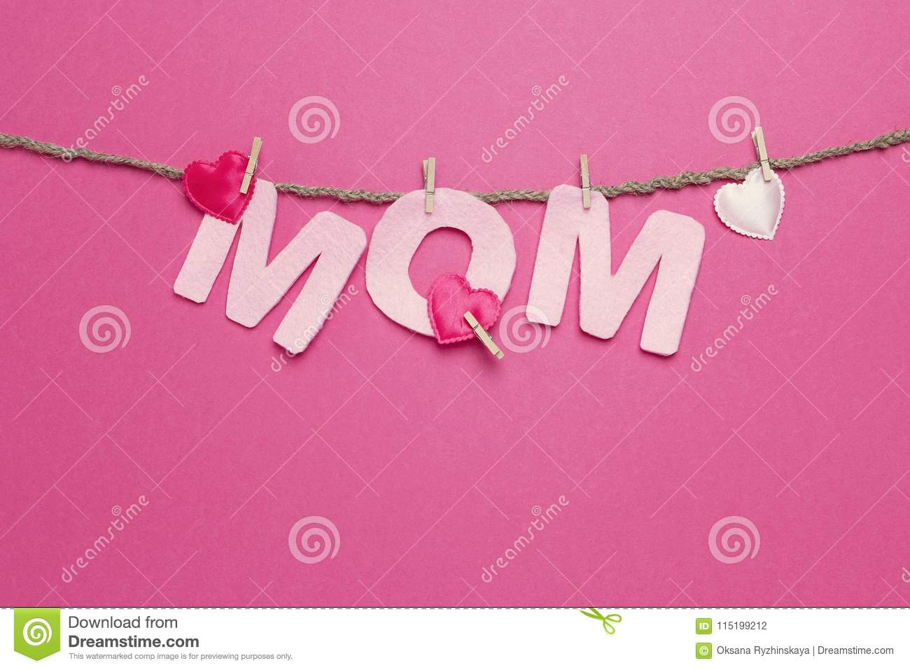 Pink Letters Mom Hang On Clothespins On Fuchsia Background. Stock